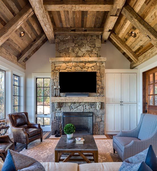 Ceiling Rafters and Stone Fireplace