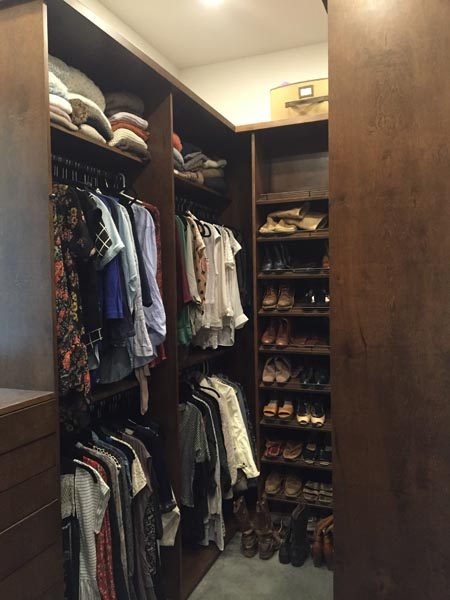 Closet Full of Clothes & Shelving Built By Garner Woodworks