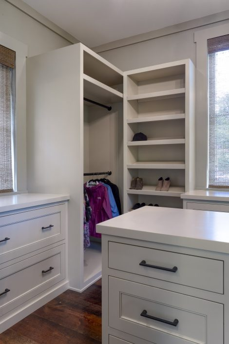 CUSTOM BUILT IN WHITE CLOSET CABINETRY